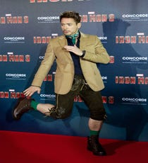 It's not the pose that is so curious about this photo of Robert Downey Jr. — it's the green-socked, neckerchief, rope-belted weirdness that&