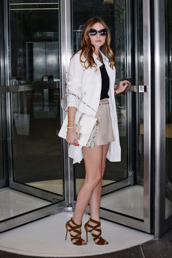 Palermo wears a Tibi Silk Strappy Cami, an Elizabeth and James Hendrick Trench, Elizabeth and James Addeline Crystal-Embellished Linen Shorts, Jimmy Choo Kemble Knotted Suede Sandals, and a Devi Kroell Moon Large Sutton bag.