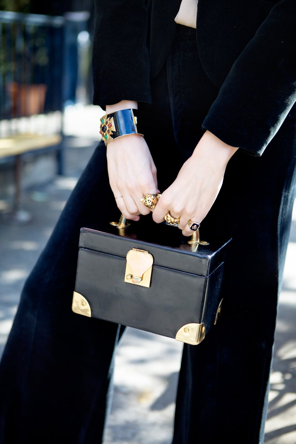 The bag is a vintage Koret bag. Her cuff is by Ciner.